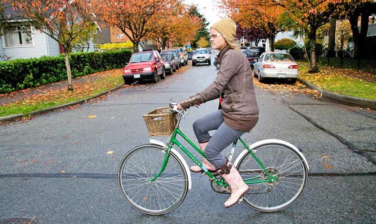 woman on a green bike