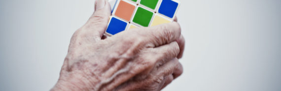 hands holding a Rubik's Cube
