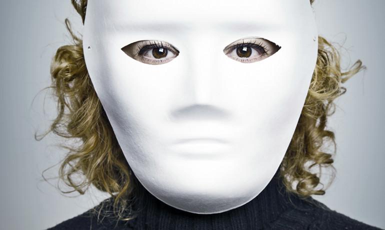 woman wearing an anonymous mask