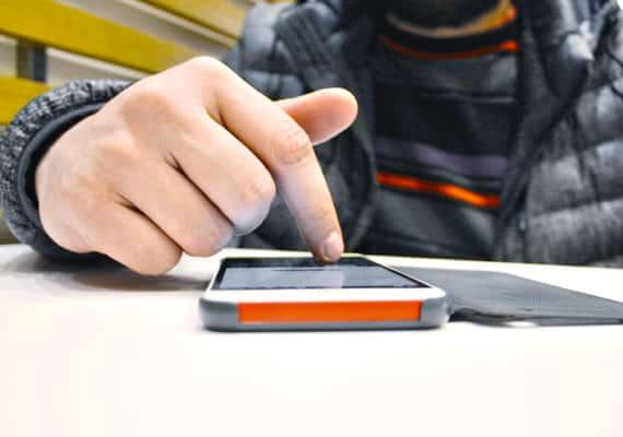 man touches phone screen