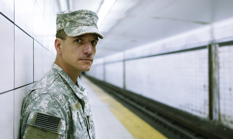 soldier in a subway tunnel