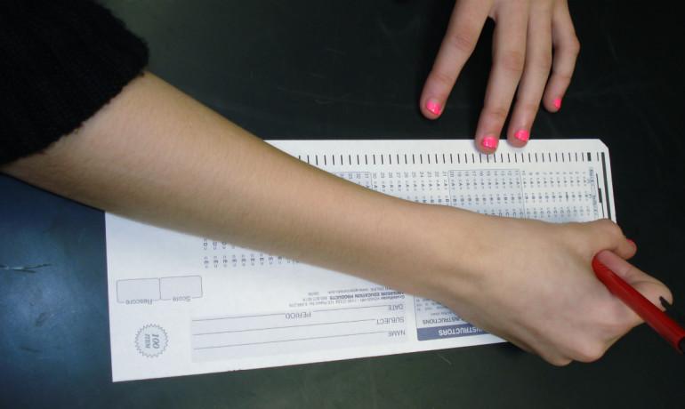 woman taking a standardized test