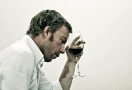 stressed man with wine