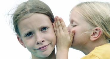 two girls share a secret