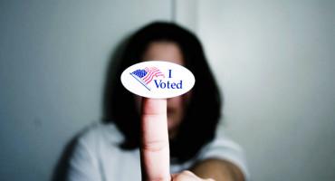 I Voted sticker on a finger tip