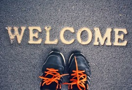 welcome mat and sneakers