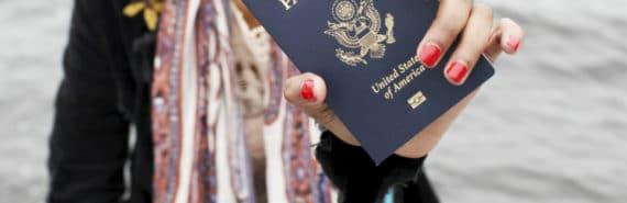 woman holding a US passport