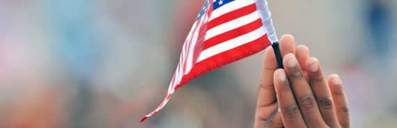 child holds a US flag