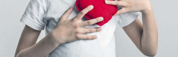 child holds a fabric heart