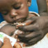 doctor measures a malnourished child's arm