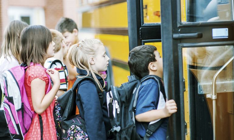 kids getting on the bus