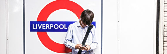 man in London uses a phone