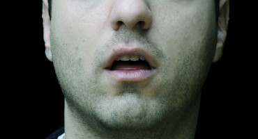man with mouth agape