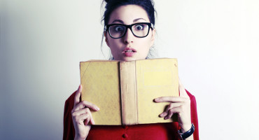 woman reading a scary book