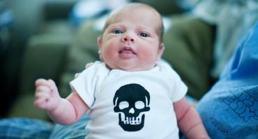 baby wearing a skull onesie