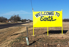 """Welcome to Earth"" sign"