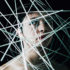 conceptual photo of man with wires near his face