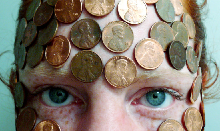 woman with pennies pasted to her forehead