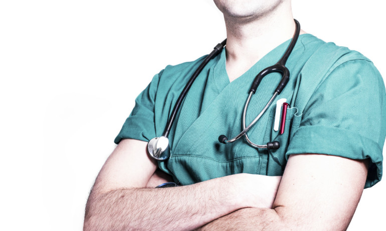 doctor with arm folded