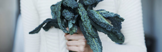 woman holds kale