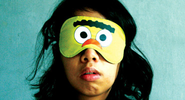 woman wears a sleep mask