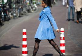 woman in a blue coat walking