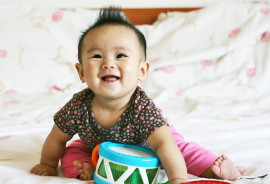 baby plays with a drum