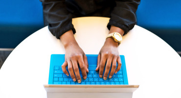 hands on blue keyboard