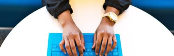 hands on blue keyboard