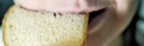 woman bites dry bread