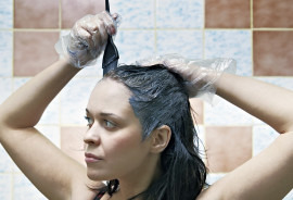 woman dyes her hair