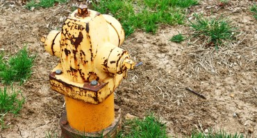 yellow hydrant and soil
