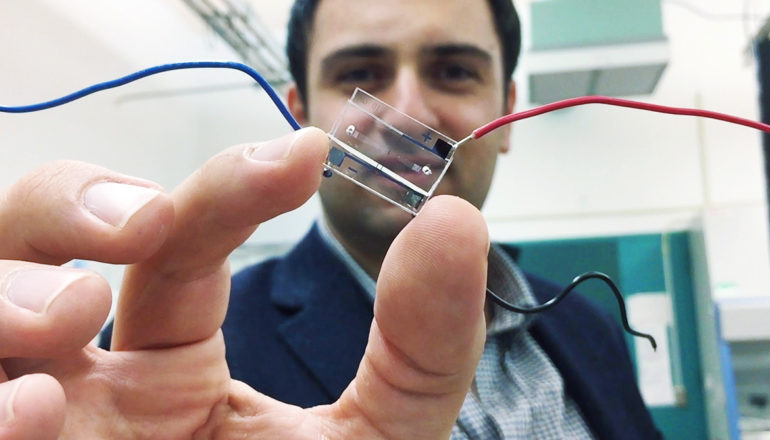 Fatih Sarioglu holds a microfluidic chip