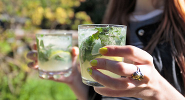 woman hold cocktails