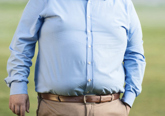 mid section of an overweight man