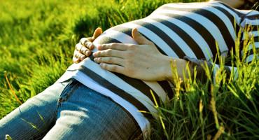 pregnant woman lies in sun
