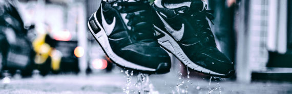 sneakers splash in puddle