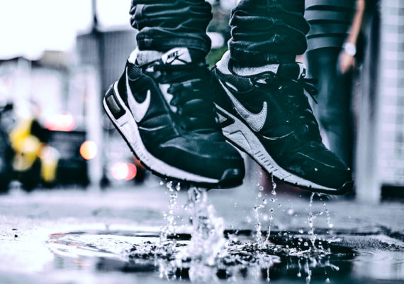 sneakers splash in puddle