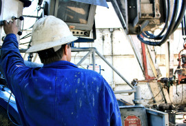 worker on oil rig deck
