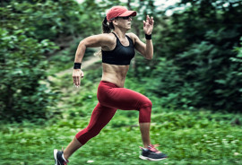 woman runs past green
