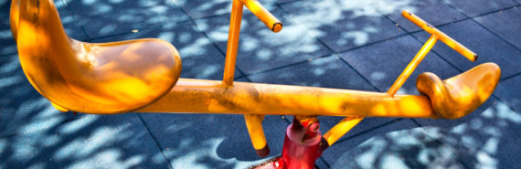 yellow see-saw on playground
