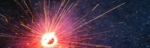 pink spark on dark background