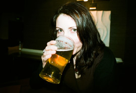 woman drinking a beer