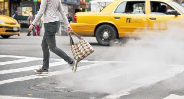 woman crossing a street