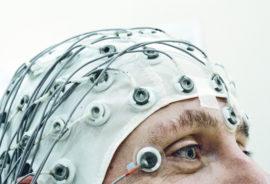 man wears an EEG cap
