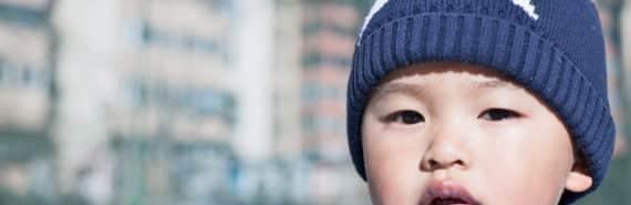 baby wears star hat
