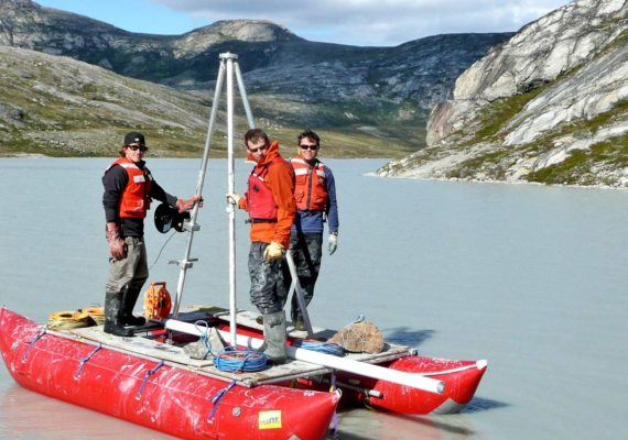 Researchers collect lake sediment cores in Greenland