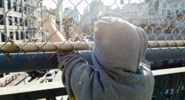 boy on a city bridge