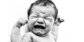 crying newborn in b/w