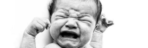 crying newborn in b/w